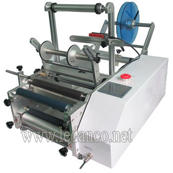 Semi-automatic round bottle decal label machine
